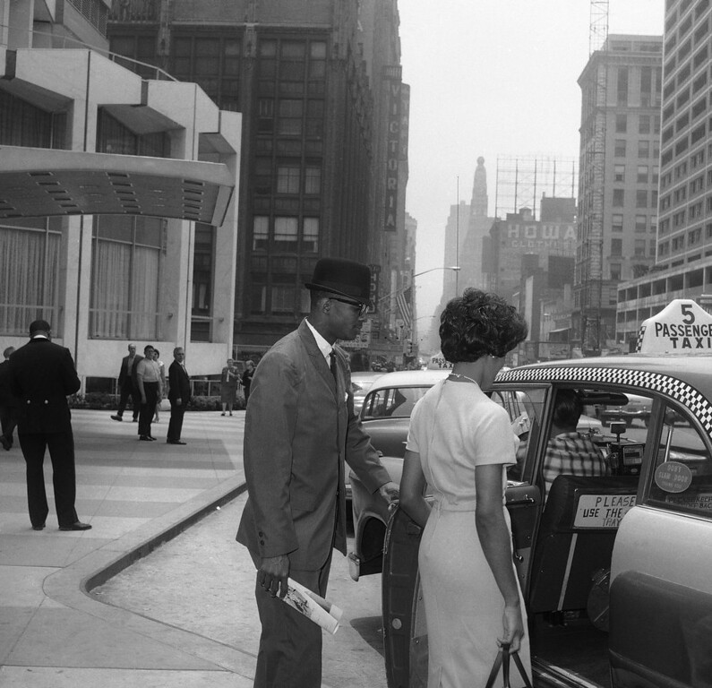 . James A. Hood of East Gadsden, Ala., and Vivian J. Malone of Mobile, Ala., on a New York City street June 9, 1963. Both are 20-years-old and will attempt to register at the University of Alabama in Tuscaloosa on June 11. Alabama Governor George Wallace said he will personally bar the two from registration despite a court order. (AP Photo/John Lindsay)