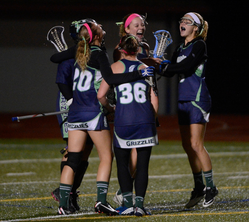 . LITTLETON, CO - MAY 8: The ThunderRidge girls lacrosse team celebrates their victory over Heritage/Littleton at Littleton Public Schools Stadium for a first round of the 2013 Colorado Girls State Lacrosse Championships May 8, 2013. ThunderRidge won 8-5. (Photo By Andy Cross/The Denver Post)