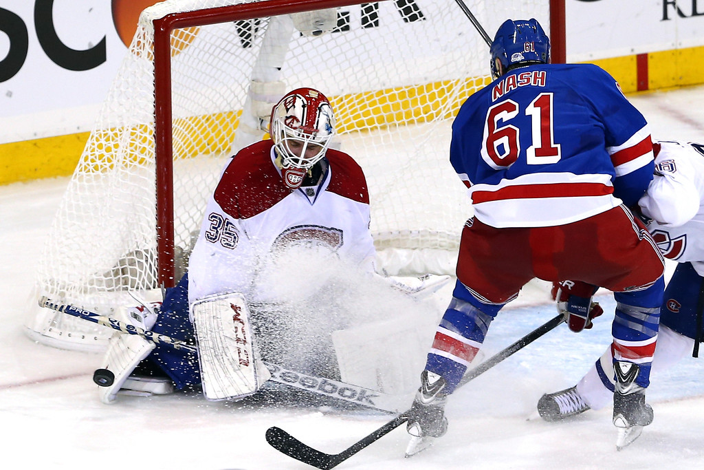 . Dustin Tokarski #35 of the Montreal Canadiens makes a save against Rick Nash #61 of the New York Rangers in Game Three of the Eastern Conference Final during the 2014 NHL Stanley Cup Playoffs at Madison Square Garden on May 22, 2014 in New York City.  (Photo by Elsa/Getty Images)