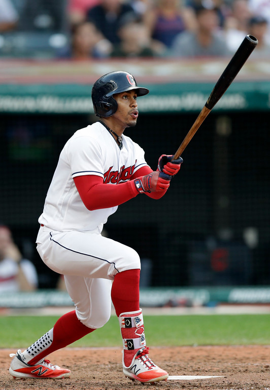 . Cleveland Indians\' Francisco Lindor watches his ball after hitting a solo home run off Kansas City Royals relief pitcher Wily Peralta in the ninth inning of a baseball game, Monday, Sept. 3, 2018, in Cleveland. The Royals won 5-1. (AP Photo/Tony Dejak)