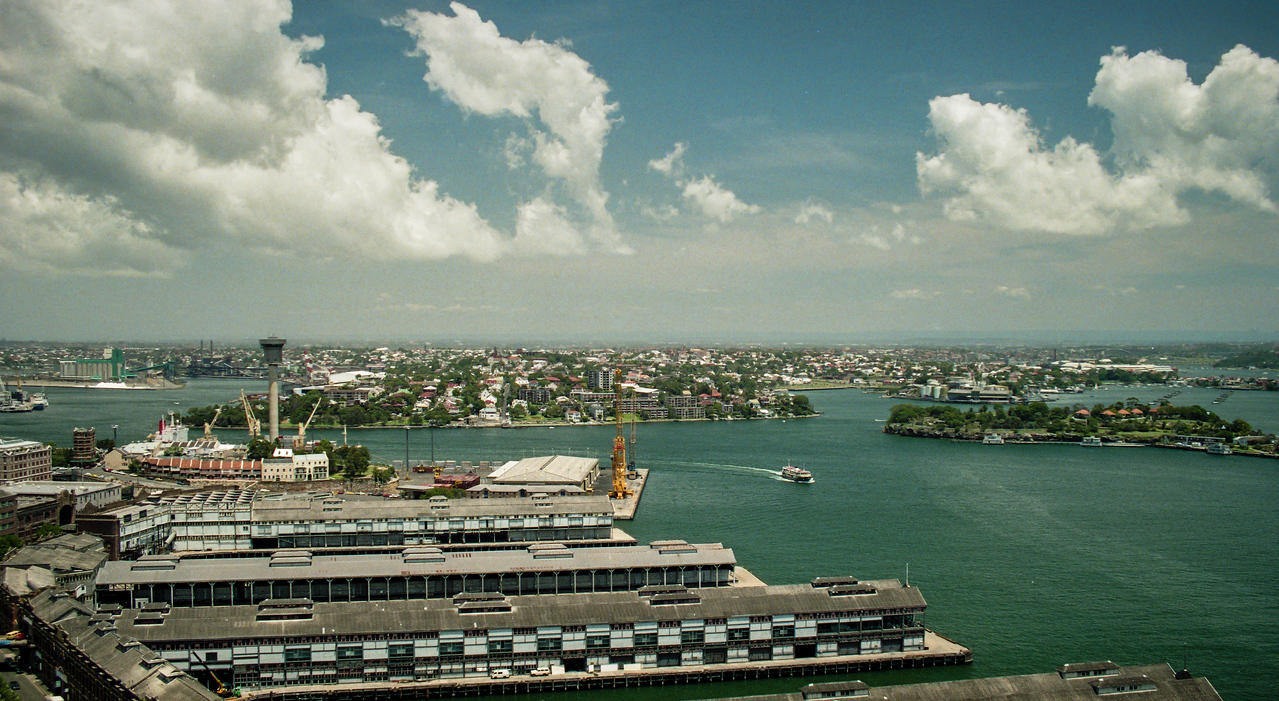 Sydney, Australia<br /> View from one of the Sydney Harbour Bridge pylons. From left to right : Hickson Rd and the wharves of Walsh Bay, grain silos and elevator on Glebe Island, Balmain, Goat Island (with the fuel depot at Ballast Point beyond) and the Gladesville Bridge in the distance.