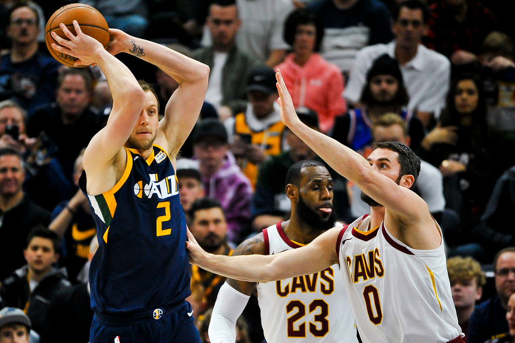 . Utah Jazz forward Joe Ingles (2) looks to pass over Cleveland Cavaliers forward Kevin Love (0) in the first half of an NBA basketball game Saturday, Dec. 30, 2017, in Salt Lake City. (AP Photo/Alex Goodlett)
