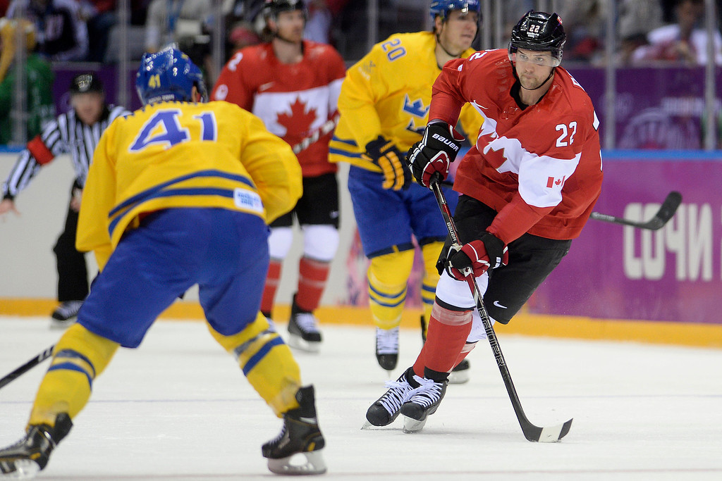 . Jamie Benn (22) of Canada brings the puck into the open ice as Gustav Nyquist (41) of Sweden defends during the first period of the men\'s ice hockey gold medal game. Sochi 2014 Winter Olympics on Sunday, February 23, 2014 at Bolshoy Ice Arena. (Photo by AAron Ontiveroz/ The Denver Post)