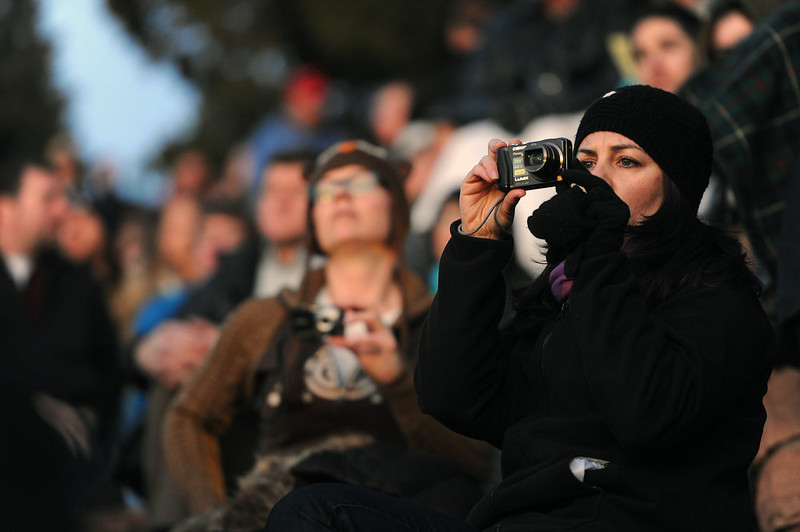 . Attendees take photos of the services as it begins.  Thousands of people turned out for the sixty sixth annual Easter sunrise service at Red Rocks Amphitheatre in Golden on March 31st, 2013.The sun rose at 6:45 am under cloudless skies and this year\'s service was pleasant with warmer temperatures than in previous years.  The service, sponsored by the Colorado Council of Churches, was led by Reverend Dr. Jim Ryan and presided over by Reverend Dr. Janet Forbes.  (Photo By Helen H. Richardson/ The Denver Post)