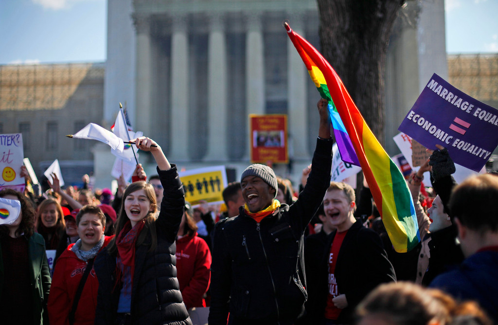 . Demonstrators chant outside the Supreme Court in Washington, Tuesday, March 26, 2013, as the court heard arguments on California\'s voter approved ban on same-sex marriage, Proposition 8. (AP Photo/Pablo Martinez Monsivais)