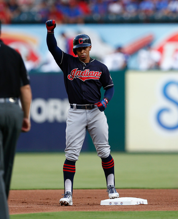 . Cleveland Indians\' Francisco Lindor celebrates his double against the Texas Rangers during the first inning of a baseball game, Saturday, July 21, 2018, in Arlington, Texas. (AP Photo/Jim Cowsert)