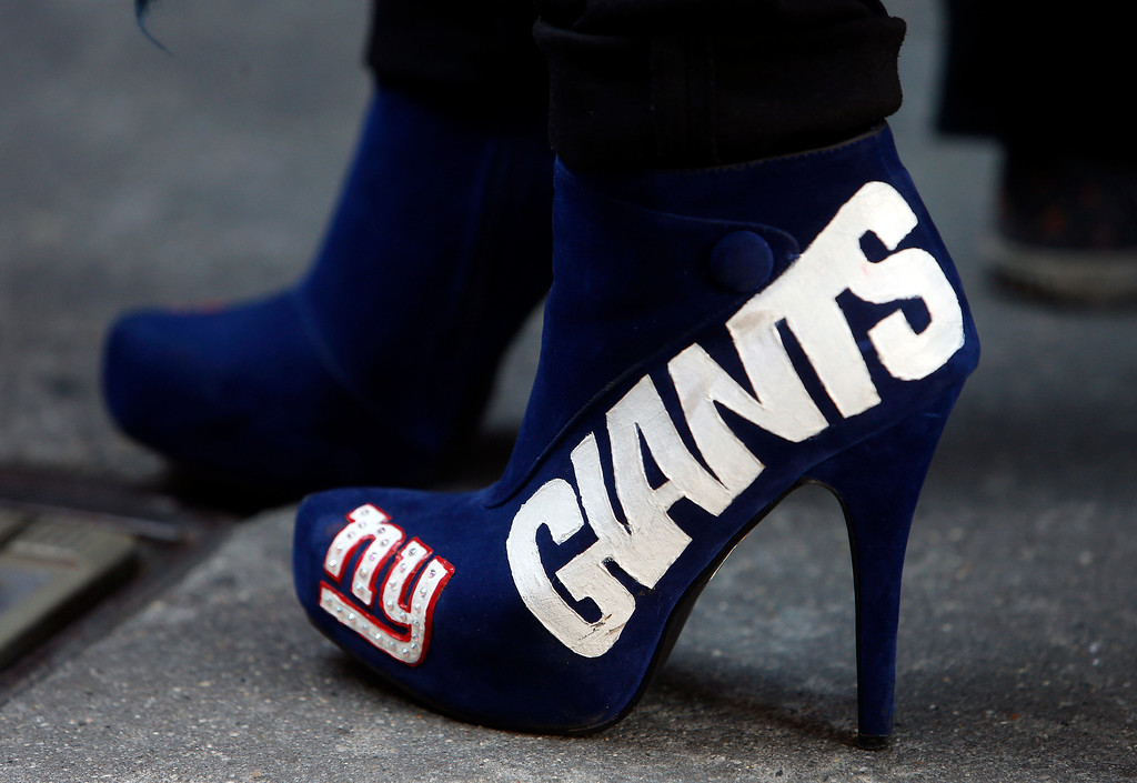 . A New York Giants fan waits in line outside Radio City Music Hall before the first round of the NFL football draft, Thursday, April 25, 2013, in New York. (AP Photo/Jason DeCrow)