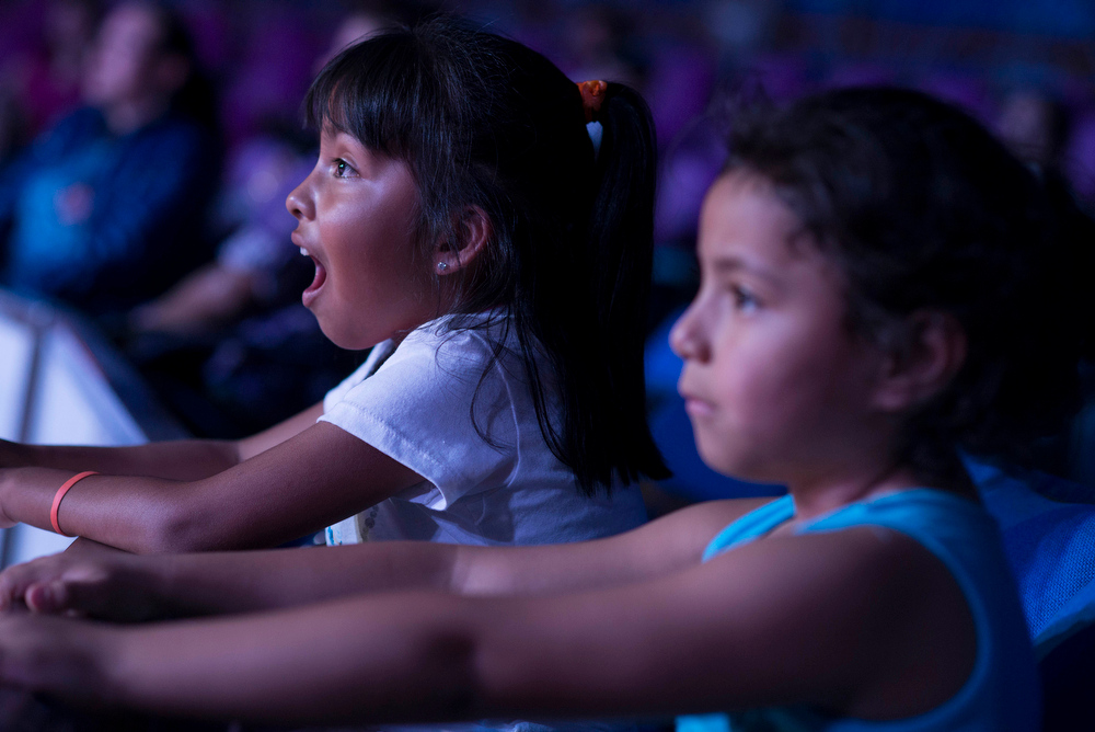 . In this June 22, 2014 photo Brenda Huerta, age 6, and her sister, Daniela, age 5 react to circus animals during a performance of the Fuentes Gasca Brothers Circus in Mexico City. Circus performers fear that without their animals they will not survive because they believe people won�t want to come to their performances only to see the acrobatic, trapeze and performances by clowns. (AP Photo/Sean Havey)