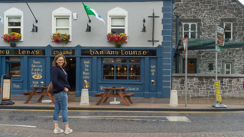 Woman standing in front of bar, Aunty Lena's Bar, Adare, County Limerick, Republic of Ireland