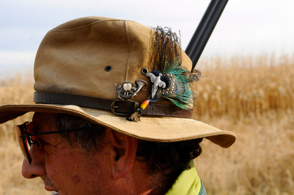 . Javier Gonzalez-Bringas, a Carbondale resident originally from Spain, shows off his well-traveled hunting hat that includes charms and exotic feathers from Africa.