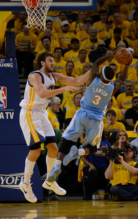 . OAKLAND, CA. - APRIL 26: Ty Lawson (3) of the Denver Nuggets takes an off balance shot over Andrew Bogut (12) of the Golden State Warriors in game 3 of the first round of the NBA Playoffs April 26, 2013 at Oracle Arena. Ty Lawson had a game high 35 points.  (Photo By John Leyba/The Denver Post)