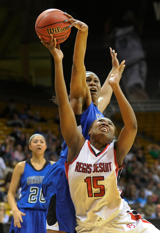 . BOULDER, CO. - MARCH 14: Raiders forward TaeKenya Akigbogun (15) had a shot blocked by Grandview defender Adaeze Obinnah (40) in the second half. The Regis Jesuit High School girl\'s basketball team edged Grandview 46-43 Thursday night, March 14, 2013 at the Coors Events Center in Boulder.  (Photo By Karl Gehring/The Denver Post)
