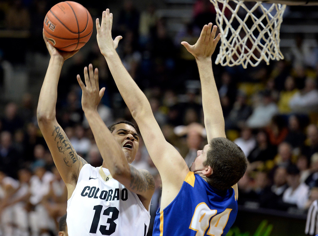 . University of Colorado\'s Dustin Thomas takes a shot over Sam Beeler during a game against  the University of California Santa Barbara, on Nov. 20, at the Coors Event Center in Boulder.  (Jeremy Papasso/Boulder Daily Camera)