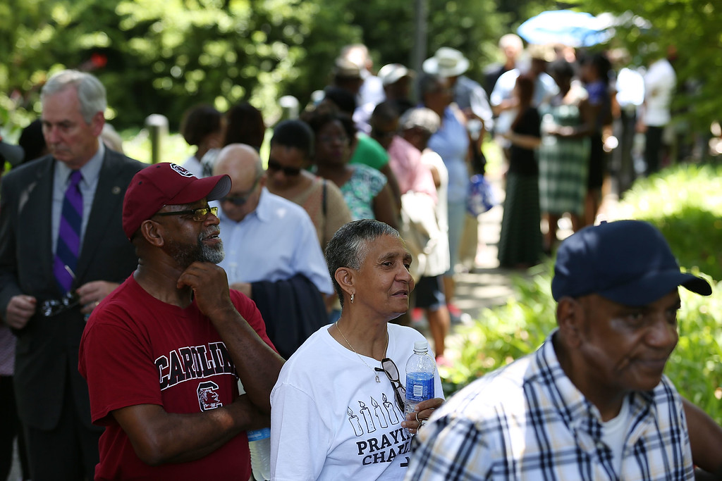 . People wait in a long line to enter the Capitol building to pay their respects to church pastor and South Carolina State Sen. Clementa Pinckney who will lie in repose at the Statehouse Rotunda on June 24, 2015 in Columbia, South Carolina. Pinckney was one of nine people killed during a Bible study inside Emanuel AME church in Charleston. U.S. President Barack Obama and Vice President Joe Biden are expected to attend the funeral which is set for Friday June 26 at the TD Arena.  (Photo by Joe Raedle/Getty Images)