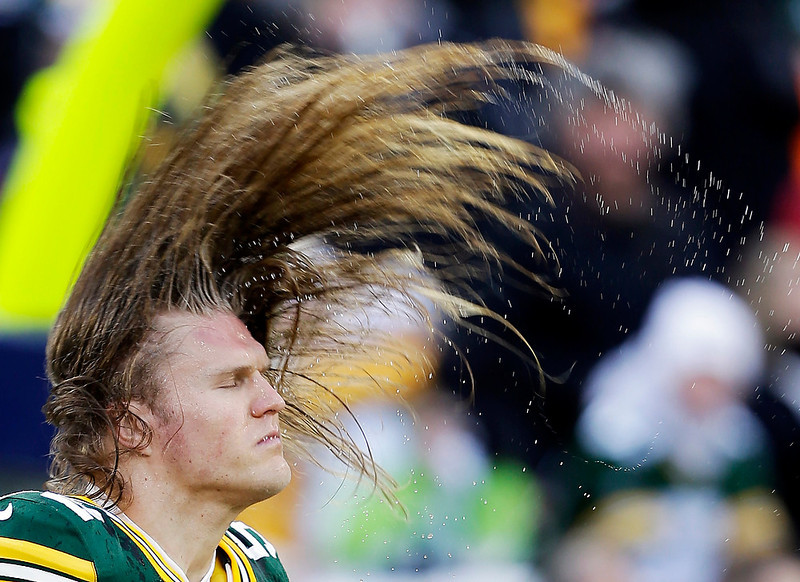 . Green Bay Packers\' Clay Matthews flips his hair after getting it wet before an NFL football game against the Tennessee Titans Sunday, Dec. 23, 2012, in Green Bay, Wis. (AP Photo/Jeffrey Phelps)