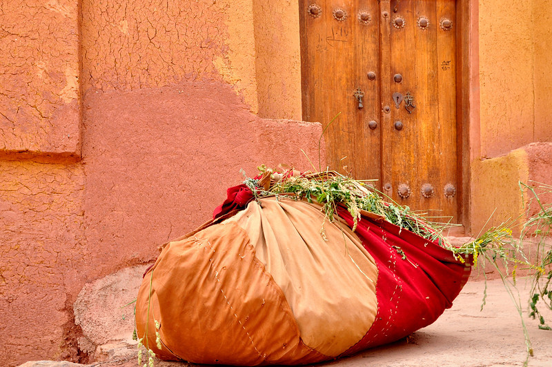 Wrapped hay in front of an old house, Abyaneh, Iran.