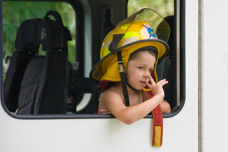 Boy in a firetruck in a parade in Stephensville, Wisconsin