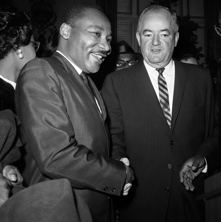 ". Vice President-elect Hubert H. Humphrey greets Dr. Martin Luther King Jr. at reception in New York?s Waldorf-Astoria Hotel on Dec. 17, 1964 at which the Nobel Peace Prize winner was honored by many dignitaries. ""No one has done more,\"" Humphrey said to King, \""to bring true meaning to the precious word--peace.\"" (AP Photo)"