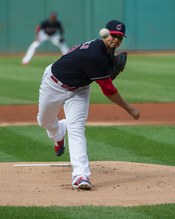 . Cleveland Indians starting pitcher Carlos Carrasco delivers to Kansas City Royals\' Whit Merrifield during the first inning of baseball game in Cleveland, Saturday, Sept. 16, 2017. (AP Photo/Phil Long)