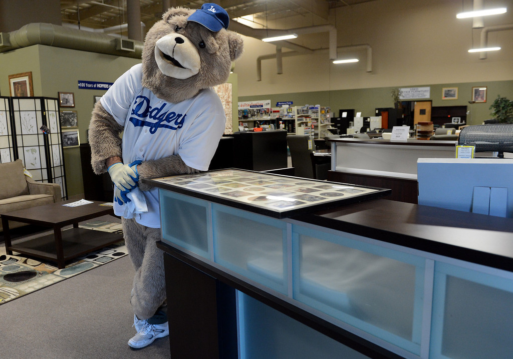 """. Mark Monninger as \""""The Bear,\"""" from Monday\'s Dodgers game, at his business Hoopers Office Furniture in Rancho Cucamonga, CA Tuesday, October 15, 2013. (Jennifer Cappuccio Maher/Inland Valley Daily Bulletin)"""