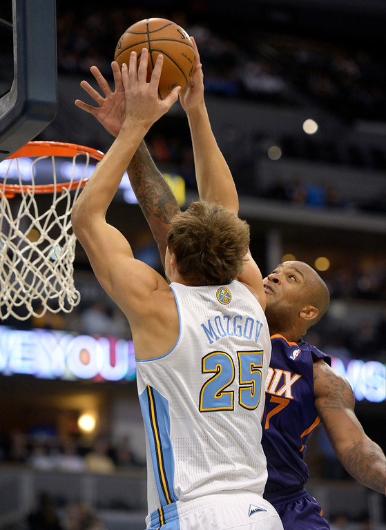 . Denver Nuggets center Timofey Mozgov (25) gets his shot blocked by Phoenix Suns shooting guard P.J. Tucker (17) during the first quarter October 23, 2013 at Pepsi Center. (Photo By John Leyba/The Denver Post)