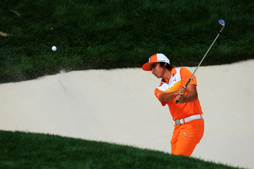 . Rickie Fowler of the United States plays a bunker shot on the 13th hole during the final round of the 95th PGA Championship on August 11, 2013 in Rochester, New York.  (Photo by David Cannon/Getty Images)