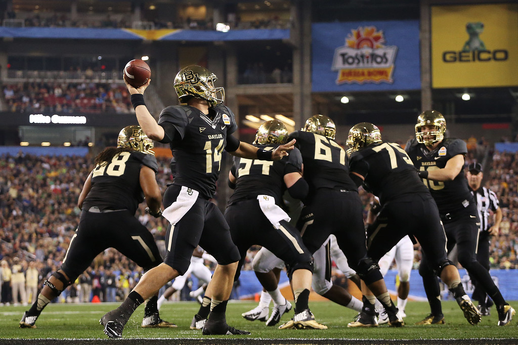 . GLENDALE, AZ - JANUARY 01:  Bryce Petty #14 of the Baylor Bears looks to pas in the first half against the UCF Knights during the Tostitos Fiesta Bowl at University of Phoenix Stadium on January 1, 2014 in Glendale, Arizona.  (Photo by Christian Petersen/Getty Images)