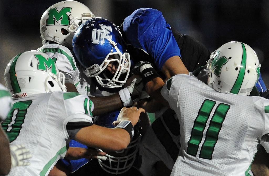 . Monrovia defense stops San Marino quarterback Andrew Ferraco in the first half of a prep football game at Monrovia High School in Monrovia, Calif., on Friday, Nov. 8, 2013.    (Keith Birmingham Pasadena Star-News)