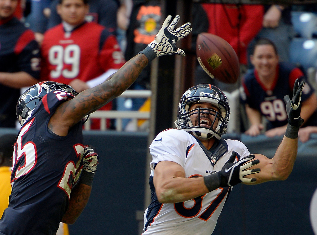. Denver Broncos wide receiver Eric Decker (87) catches his 10th touchdown of the year on Houston Texans cornerback Kareem Jackson (25) during the fourth quarter December 22, 2013 at Reliant Stadium. (Photo by John Leyba/The Denver Post)