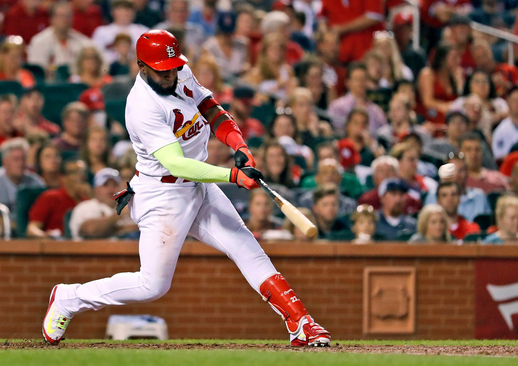 . St. Louis Cardinals\' Marcell Ozuna hits a two-run double during the third inning of a baseball game against the Cleveland Indians Monday, June 25, 2018, in St. Louis. (AP Photo/Jeff Roberson)