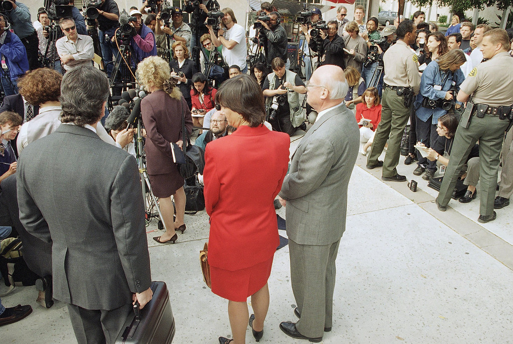 . Defense Attorneys Barry Levin, left, Terri Towery, center, and lead counsel for Lyle Menendez, Charles Gessler, right, stand back as Leslie Abramson, defense attorney for Erik Menendez speaks to the media, April 17, 1996, outside the courthouse in the Van Nuys section of Los Angeles after the jury announced its recommendation of life in prison without possibility of parole for the two brothers for the 1989 murder of their parents. (AP Photo/Damian Dovarganes)