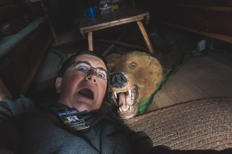 (Goofball supreme) Philmont NPS Lead Marketing Specialist Alexander Bohlen takes a selfie with the bear rug at Fish Camp. Photo by Alexander Bohlen