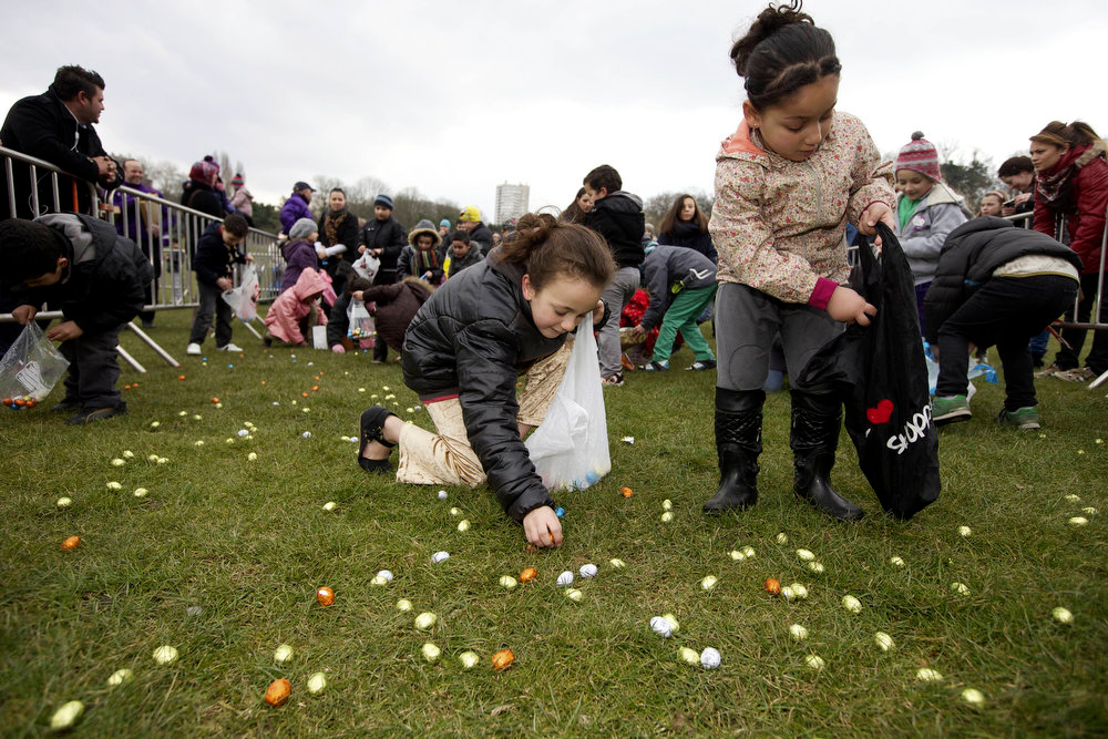 Description of . Children gather chocolate eggs during an Easter egg hunt on March 31, 2013.  NICOLAS MAETERLINCK/AFP/Getty Images