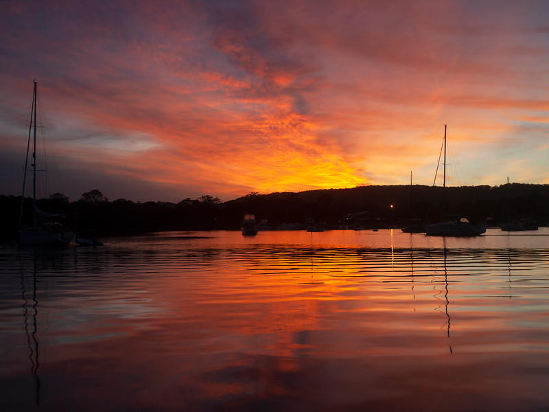 Orange-red stratocumulus cloudy Sunrise Seascape. Australia