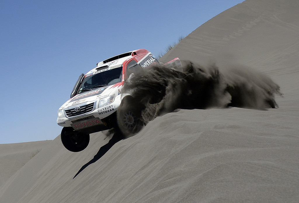 . Toyota\'s driver Giniel De Villiers of South Africa and co-driver Dirk Von Zitzewitz of Germany, compete during the Stage 2 of the Dakar 2014 between San Luis and San Rafael, Argentina, on January 6, 2014.   FRANCK FIFE/AFP/Getty Images