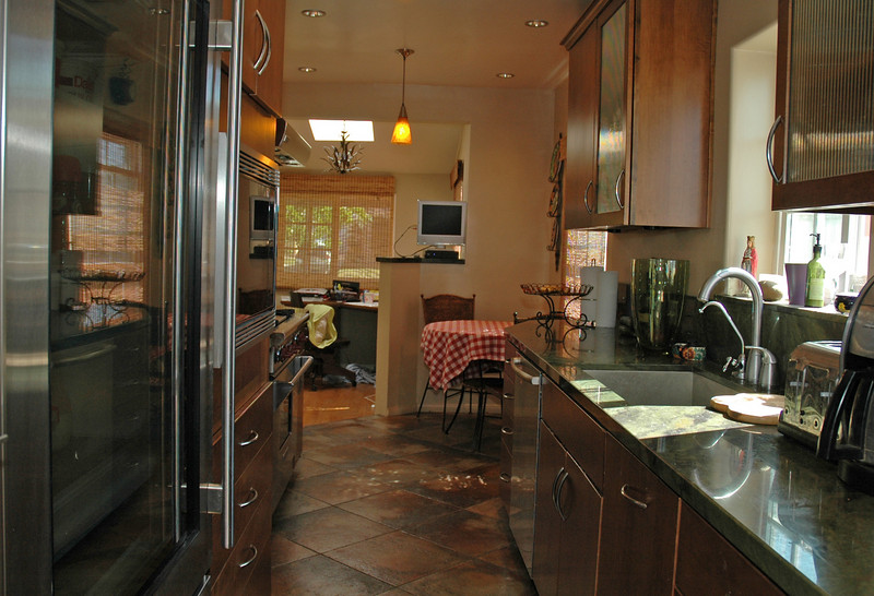 The kitchen is equipped with a Sub Zero 650G Built-in Refridgerator. The glass door offers a more commercial look.