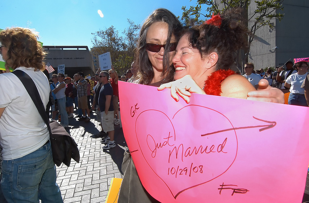 . 11/15/08:  Kimberly Esslinger, left, and Marie Cartier, recently were married on October 29, 2008 aboard the Queen Mary and gathered along side roughly a thousand participants in a peace rally organized by the Center Long Beach for National Day of Support for California Marriage Equality held at Centennial Plaza inside Long Beach City Hall on Saturday, November 15, 2008. Photo by Diandra Jay/Press-Telegram