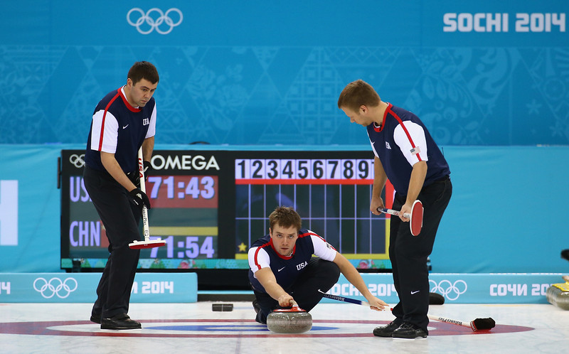 . (L-R) Teammates John Landsteiner, Jeff Isaacson and Jared Zezel of the USA compete in the men\'s round robin session against China during day four of the Sochi 2014 Winter Olympics at Ice Cube Curling Center on February 11, 2014 in Sochi, Russia.  (Photo by Streeter Lecka/Getty Images)