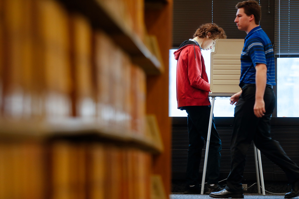 . A voter fills out his ballot at a polling station at the University of Cincinnati, Tuesday, Nov. 7, 2017, in Cincinnati. Ohio voters will decide ballot issues on Tuesday that would place limits on drug prices and expand victims\' rights in criminal proceedings, along with several mayoral races. (AP Photo/John Minchillo)