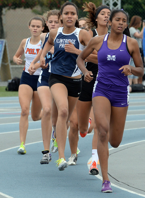 . Flintridge Prep\'s Sarah Yoho competes in the division 4 1600 meter race during the CIF Southern Section track and final Championships at Cerritos College in Norwalk, Calif., on Saturday, May 24, 2014.   (Keith Birmingham/Pasadena Star-News)