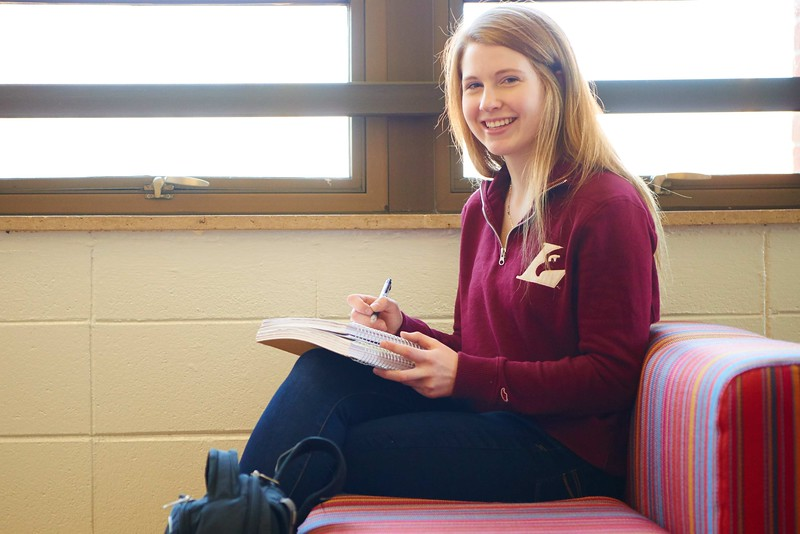 -UWL UW-L UW-La Crosse University of Wisconsin-La Crosse; Candid; Couch; day; December; Eagle L; Graff Main Hall; Inside; Notepad; Pen; Pencil; Portrait; Smiling; Student students; Studying; Woman women