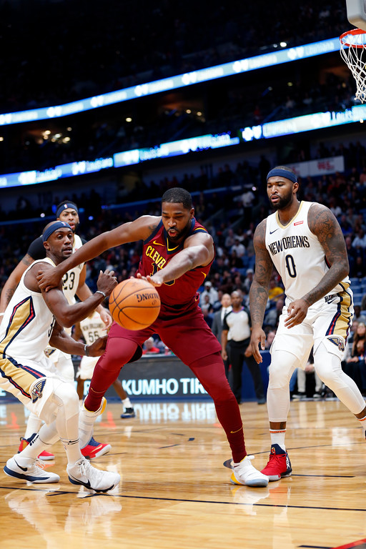 . Cleveland Cavaliers center Tristan Thompson battles for a loose ball in front of New Orleans Pelicans forward DeMarcus Cousins (0) and forward Dante Cunningham in the first half of an NBA basketball game in New Orleans, Saturday, Oct. 28, 2017. (AP Photo/Gerald Herbert)