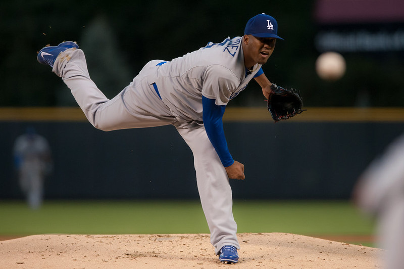 . Roberto Hernandez #55 of the Los Angeles Dodgers pitches in the first inning of a game against the Colorado Rockies at Coors Field on September 15, 2014 in Denver, Colorado.  (Photo by Dustin Bradford/Getty Images)