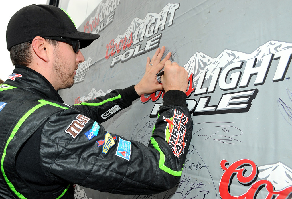 . LOUDON, NH - JULY 13:  Kyle Busch, driver of the #54 Monster Energy Toyota, signs the wall in Victory Lane after qualifying for the pole position in the NASCAR Nationwide Series CNBC Prime\'s The Profit 200 at New Hampshire Motor Speedway on July 13, 2013 in Loudon, New Hampshire.  (Photo by Jared C. Tilton/Getty Images)