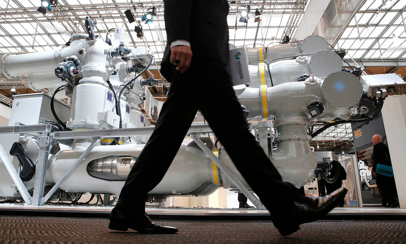 . A visitor walks past a T155 Gas-insulated substation by Alstom at the Hanover Messe on the first day of the industrial trade fair, in Hanover April 8, 2013. The Hanover fair runs from April 8 -12. REUTERS/Fabrizio Bensch