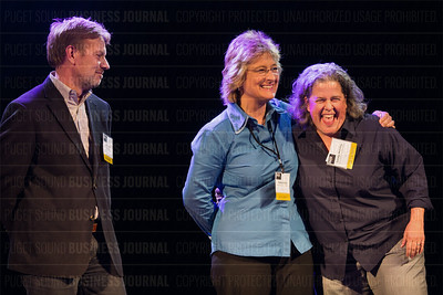 Joe Fugere (from left) of Tutta Bella, Gladys Gillis of Starline Luxury Coaches and Lendy Hensley of City Catering Company were honored for finishing first, second and third respectively in the Business of Pride Top 25 LGBTQ business list makers at the Puget Sound Business Journal's The Business Of Pride at the Paramount Theatre in Seattle on Thursday, May 26, 2016. (BUSINESS JOURNAL PHOTO | Dan DeLong)