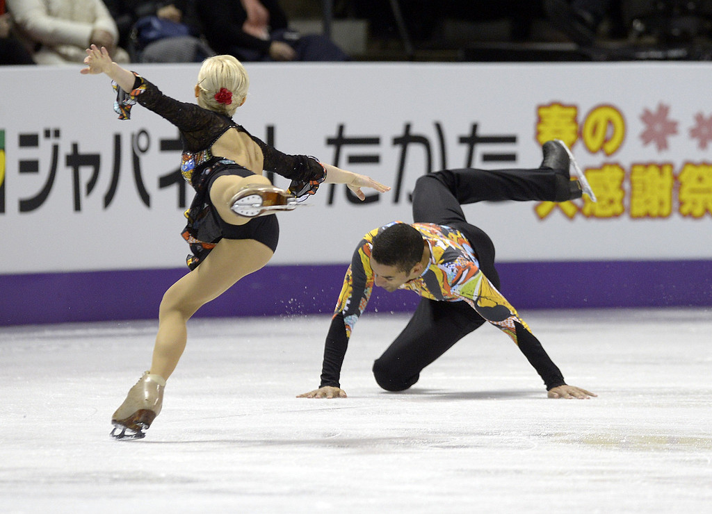 . Aliona Savchenko watches as Robin Szolkowy falls as they compete for Germany during the Pairs Free Skating event at the 2013 World Figure Skating Championships March 15, 2013 in London, Ontario, Canada. Skaters from around the globe are competing in the four day event to become the world champions in mens, ladies, pairs and ice dance figure skating.  AFP PHOTO/Brendan  SMIALOWSKI/AFP/Getty Images
