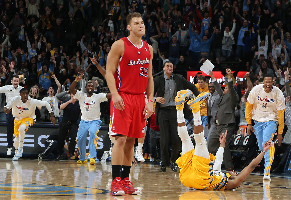. Los Angeles Clippers forward Blake Griffin, front, reacts as Denver Nuggets guard Randy Foye, celebrates after hitting a 3-point basket with nine-tenths of second remaining in the fourth quarter of the Nuggets\' 116-115 victory in an NBA basketball game in Denver, Monday, Feb. 3, 2014. (AP Photo/David Zalubowski)