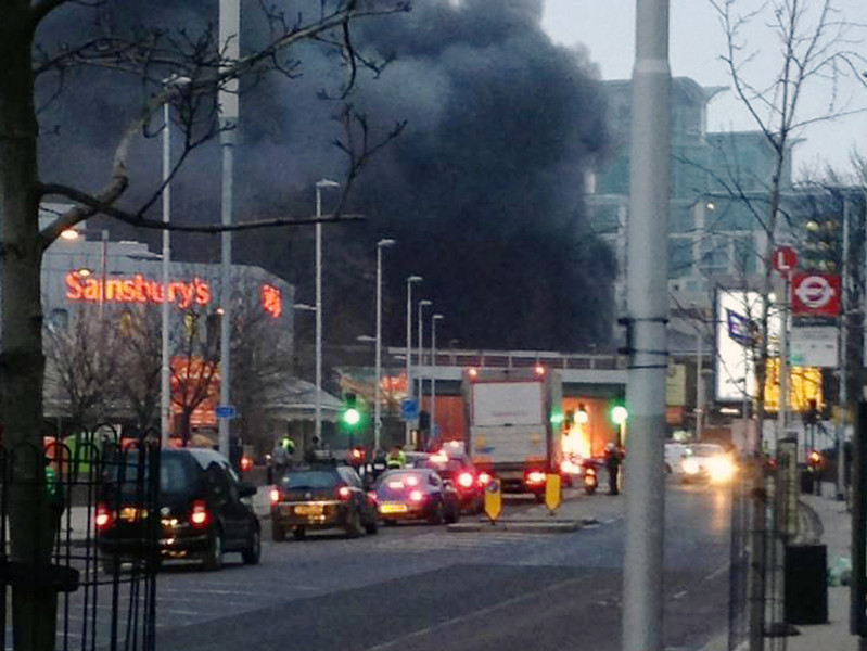 . Smoke billows from the scene following a helicopter crash in central London, after it hit a crane on St. George\'s Tower building in the Vauxhall area of central London, Wednesday Jan. 16, 2013.  Police say two people were killed when a helicopter crashed during rush hour in central London after apparently hitting a construction crane on top of a building, obscured behind smoke. (AP Photo/Max James Tolhurst, PA)