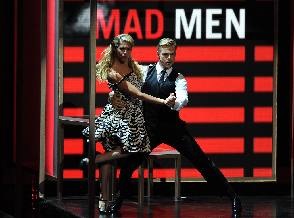. Choreographer Derek Hough (L) performs onstage during the 65th Annual Primetime Emmy Awards held at Nokia Theatre L.A. Live on September 22, 2013 in Los Angeles, California.  (Photo by Kevin Winter/Getty Images)